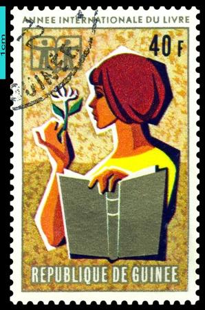 guinee: REPUBLIQUE  DE GUINEE - CIRCA 1972: A Stamp printed in the  Republique de Guinee shows  Children, Girl and Book  ,  series, circa 1972 Stock Photo