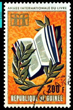 guinee: REPUBLIQUE DE GUINEE - CIRCA 1972: A Stamp printed in the Republique de Guinee shows  Children, Book  and Branch, circa 1972 Stock Photo
