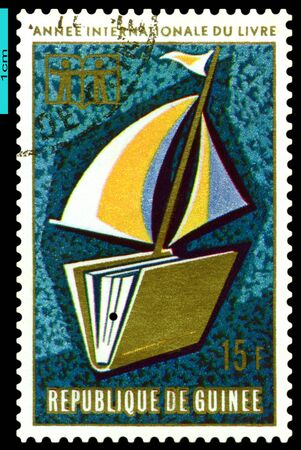 REPUBLIQUE DE GUINEE - CIRCA 1972: A Stamp printed in the Republique de Guinee shows  Children, Book  and Sail, circa 1972 photo