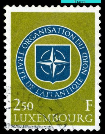 nato: LUXEMBOURG - CIRCA 1959   A stamp printed in Luxembourg,  shows  Emblem NATO, circa 1959