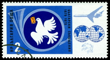 BULGARIA - CIRCA 1979  A stamp printed by  Bulgaria shows  image Post Horn, Globe, Carrier  Pigeon and Air mail,  circa 1979 Stock Photo - 13436601