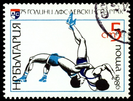 BULGARIA - CIRCA 1986  a stamp printed by Bulgaria, shows Wrestling  Levsky - Spartak Sports Club, 75th anniv , circa 1986 Stock Photo - 13847152