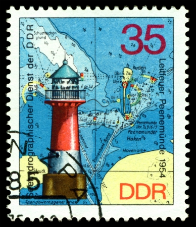 GERMANY - CIRCA 1975  stamp printed by Germany, shows Lighthouse Peenemunde  1954 , Series Lighthouses, Maps and Nautical Charts, circa 1975   photo