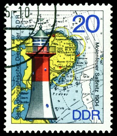 GERMANY - CIRCA 1975  stamp printed by Germany, shows Lighthouse Sassnitz   1904 , Series Lighthouses, Maps and Nautical Charts, circa 1975   photo