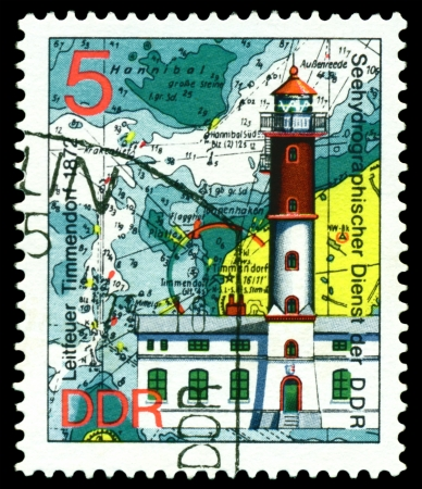 GERMANY - CIRCA 1975  stamp printed by Germany, shows Lighthouse Timmendorf  1872 , Series Lighthouses, Maps and Nautical Charts, circa 1975   photo