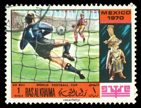 RAS AL KHAIMA - CIRCA 1970  a stamp printed by  RAS  AL KHAIMA  shows game in football  World  football cup in Mexico, circa 1970