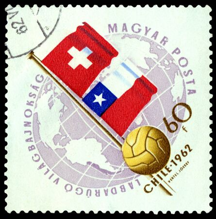 Hungary - CIRCA 1962  a stamp printed by Hungary shows flag of Switzerland and Chile  World  football cup in Chile, circa 1962 photo