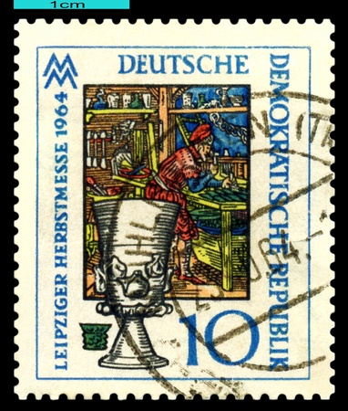 glasier: GDR - CIRCA 1964  A stamp printed in the GDR shows  Medieval Glasier and Goblet,  Jena Glass for chemical industry, circa 1964