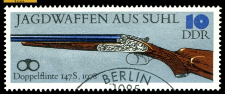 GERMANY - CIRCA 1978: post stamps printed in Germany,  shows  antique  Double -Barreled Gun. 1978,  Hunting Guns series, circa 1978  photo