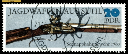 GERMANY - CIRCA 1978: post stamps printed in Germany,  shows  antique  Spring-cock  Gun. 1780,  Hunting Guns series, circa 1978 Stock Photo - 16292720