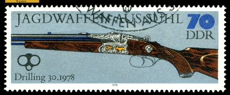 GERMANY - CIRCA 1978: post stamps printed in Germany,  shows  antique Three-Barreled Gun. 1978,  Hunting Guns series, circa 1978 Stock Photo - 16292717