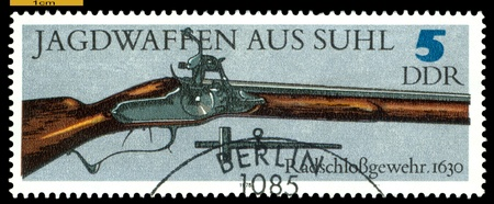 GERMANY - CIRCA 1978: post stamps printed in Germany,  shows  antique  Wheel-lock Gun. 1630. Hunting Guns series, circa 1978  Stock Photo - 16292714