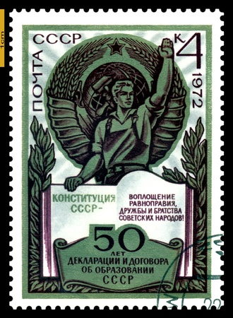 USSR-CIRCA 1972  A stamp printed in the USSR,  Arms USSR, Worker, Book  50 years to Declarations and agreement on formation USSR, circa 1972  Stock Photo - 16704867