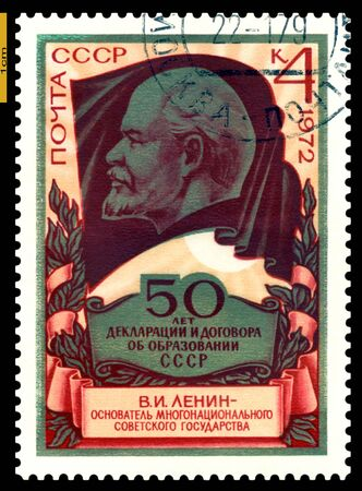 USSR-CIRCA 1972  A stamp printed in the USSR, shows portrait Lenin on background of the flag, 50 years to Declarations and agreement on formation USSR, circa 1972  Stock Photo - 16704862