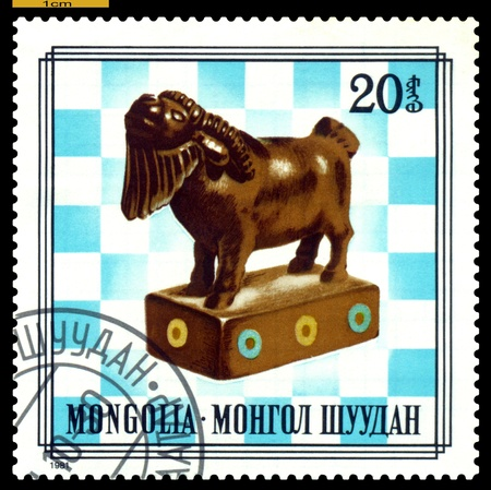 MONGOLIA - CIRCA 1981  A post stamp printed in Mongolia, shows   unique wood chess-men on chess-board, series,  circa 1981 Stock Photo - 16976982