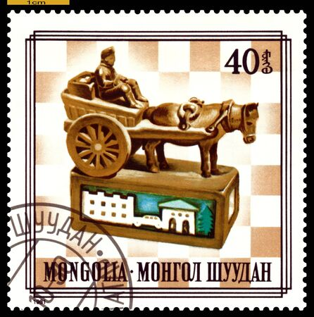 MONGOLIA - CIRCA 1981  A post stamp printed in Mongolia, shows   unique wood chess-men on chess-board, series,  circa 1981 Stock Photo - 16976983
