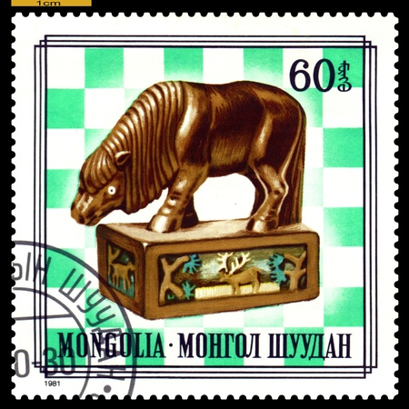 postmail: MONGOLIA - CIRCA 1981  A post stamp printed in Mongolia, shows   unique wood chess-men on chess-board, series,  circa 1981