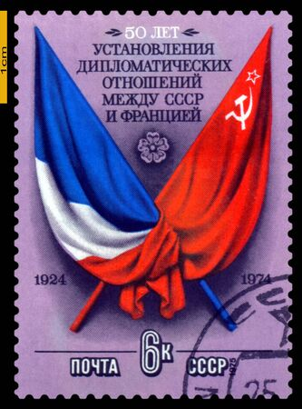 perforated stamp: RUSSIA - CIRCA 1974: a stamp printed by  Russia , shows Flags of USSR and France,  50th anniversary of the establishment of Diplomatic relations between   USSR and France, circa 1974