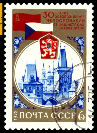 USSR - CIRCA 1975: a stamp printed by USSR shows  Russian and Czechoslovakia Flags, Arms, Charles Bridge Towers, 30th anniversary liberation Czechoslovakia  from  Fascism, circa 1975 Stock Photo - 17857876