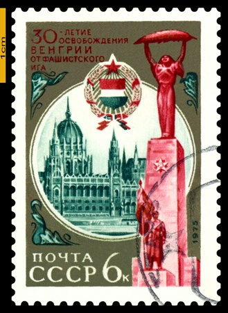 USSR - CIRCA 1975  a stamp printed by USSR shows   Hungary  Arms and Liberation Monument Parliament, 30th anniversary liberation  Hungary  from  Fascism, circa 1975 Stock Photo - 17857483