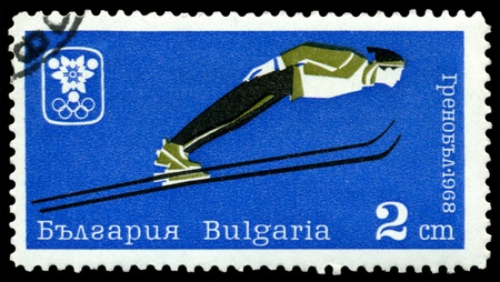 Bulgaria - CIRCA 1968: a stamp printed by Bulgaria, shows jumps from a springboard, circa 1968 in Grenoble, France