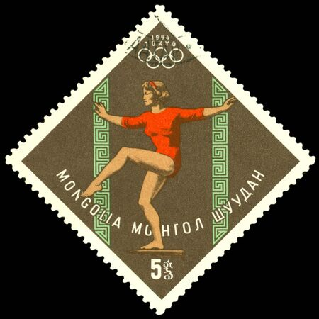 Mongolia- CIRCA 1964: a stamp printed by Mongolia, shows gymnast.  games in Tokyo , circa 1964 Japan
