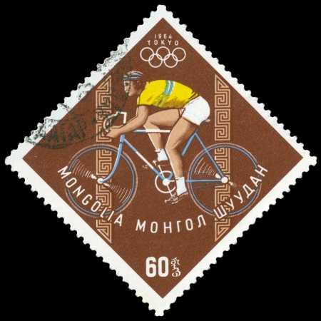 Mongolia- CIRCA 1964: a stamp printed by Mongolia, shows bicyclist.  games in Tokyo , circa 1964 Japan
