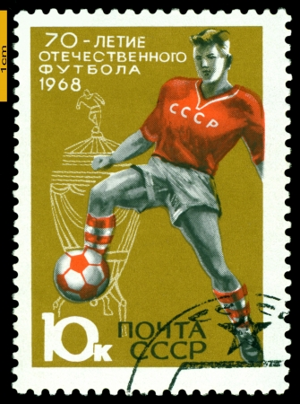 USSR - CIRCA 1968: a stamp printed by USSR shows  Soccer player and Cup, European youth sports competitions, circa 1968