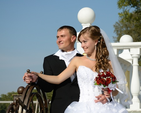 onward: Bride and groom at the helm of the family ship. Together boldly look onward. Stock Photo