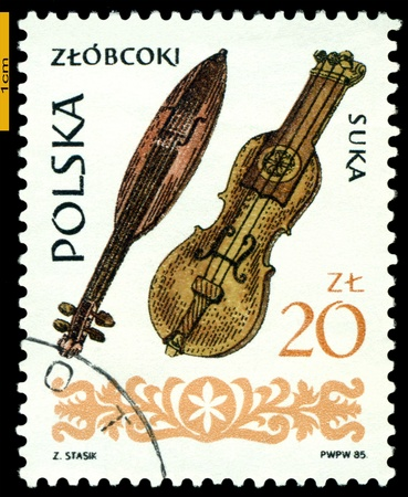 fiddles: POLAND - CIRCA 1985: A Stamp printed by Poland shows  Wooden  Fiddles, series people  instruments, circa 1985