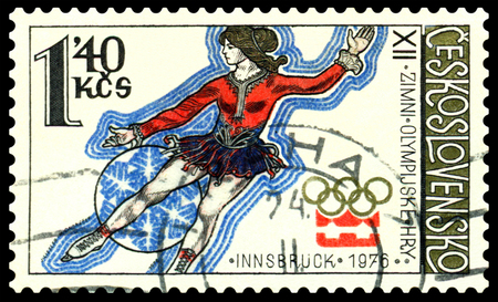olympic symbol: CZECHOSLOVAKIA  - CIRCA 1976  a stamp printed by  Czechoslovakia , shows  Figure Skater   Olympic games in Innsbruck,  series, circa 1976 Editorial