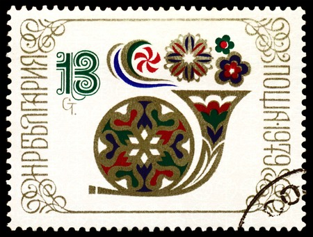 BULGARIA - CIRCA 1979  a stamp printed by Bulgaria, shows Post horn - a symbol of the new year Stock Photo