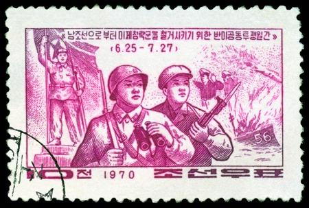 partisan: DPR KOREA - CIRCA 1970  a stamp printed by  DPR Korea , shows Soldier and partisan, circa 1970