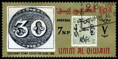 philatelic: UMM  AL QIWAIN - CIRCA 1966  a stamp printed by  Umm al Qiwain  shows Emblem Philatelic Exhibition Cairo 1966, circa 1966