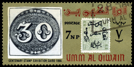 UMM  AL QIWAIN - CIRCA 1966  a stamp printed by  Umm al Qiwain  shows Emblem Philatelic Exhibition Cairo 1966, circa 1966