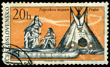 Czechoslovakia - CIRCA 1966: a stamp printed by Czechoslovakia shows a picture from life injun. Conversation. Circa 1966 版權商用圖片
