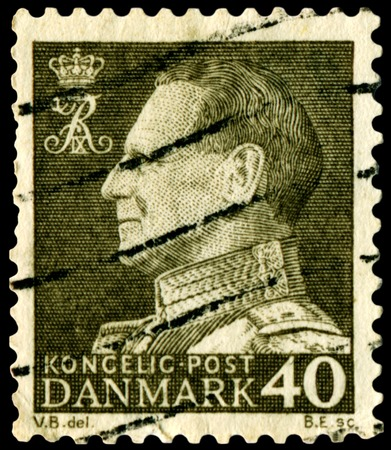 ix portrait: DENMARK - CIRCA 1956: A stamp printed in Denmark shows a portrait  King Frederick IX, circa 1956 Editorial