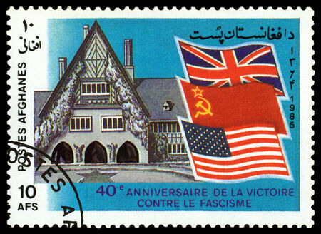 philately: AFGANISTAN - CIRCA 1985: a stamp printed by Afganistan  shows  Caecilienhof, site of Potsdam  Treaty signing.  Great Britain, USSR, &  US,  Flags, circa 1985