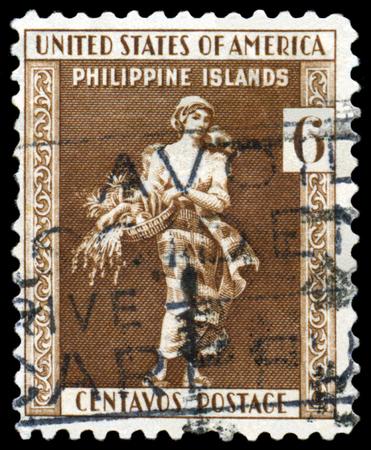 filipina: PHILIPPINES - CIRCA 1935: A Stamp printed in the Philippunes shows portrait La Filipina, circa 1935