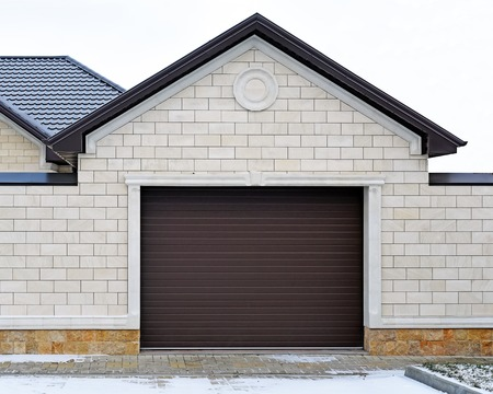 Garage with modern gate. Design of the facade of the estate. photo