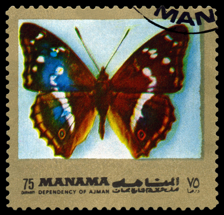 ajman: AJMAN - CIRCA 1972: A stamp printed in Ajman shows butterfly  Apatura Iris, circa 1972. Stock Photo