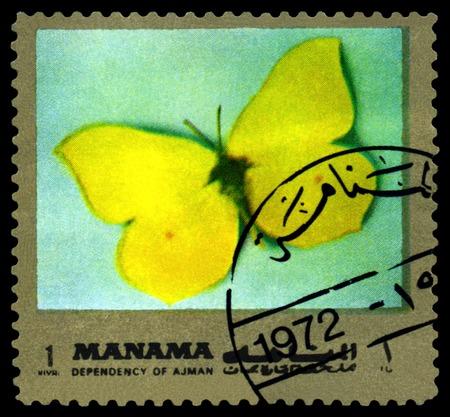 gonepteryx: AJMAN - CIRCA 1972: A stamp printed in Ajman shows butterfly  Gonepteryx rhamni, circa 1972.