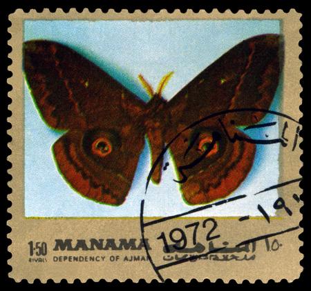 ajman: AJMAN - CIRCA 1972: A stamp printed in Ajman shows butterfly  Salassa lola, circa 1972.