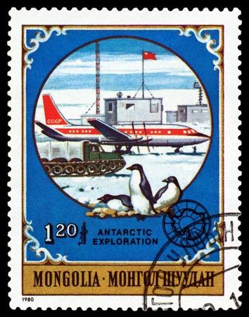 MONGOLIA - CIRCA 1980: a stamp printed by Mongolia  shows  Soviet plane and  penguins,  Antarctic Animals and exploration,  circa 1980 Editöryel