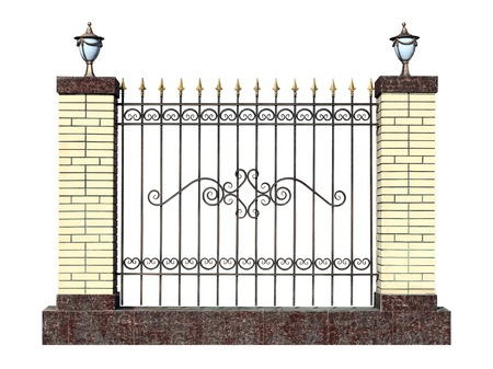 Decorative forged fence with pillar  in old  stiletto. Isolated over white background.