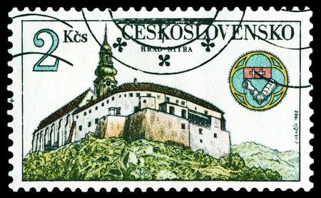 arhitecture: CZECHOSLOVAKIA - CIRCA 1982: a stamp printed by Czechoslovakia, shows Nitra Castle and emblem, circa 1982 Stock Photo