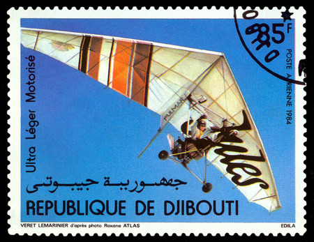 philately: STAVROPOL, RUSSIA - APRIL 05, 2016: a stamp printed by Djibouti  shows manned flight on Motorized Hang Glider, circa 1984