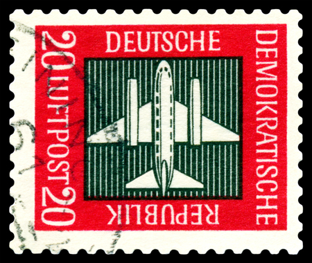gdr: STAVROPOL, RUSSIA - APRIL 05, 2016: a stamp printed by GDR  shows  Stilized plane, payment airmail, circa 1957 Stock Photo