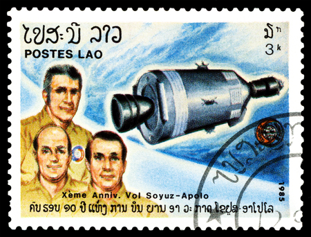 soyuz: STAVROPOL, RUSSIA - MARCH 30, 2016: a stamp printed by Laos  shows flight the Apollo and Soyuz, 10th anniversary, circa 1985.