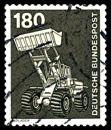 wheel loader: STAVROPOL, RUSSIA - APRIL 04, 2016: a stamp printed by  Germany , shows   Wheel loader, series Industry and Technology,  circa 1975